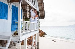 Young couple in tropical beach house Stock Photos