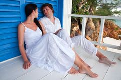 Young couple in tropical beach house Stock Photo