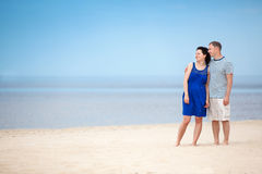 Young couple at tropical beach on summer vacation Royalty Free Stock Photos