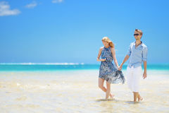 Young couple on a tropical island Stock Photos