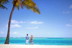 Young couple on a tropical island Stock Photos