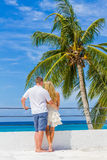 Young couple on tropical island, outdoor wedding ceremony Stock Photos
