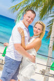 Young couple on tropical island, outdoor wedding ceremony Royalty Free Stock Images