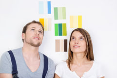 Young couple trying to decide on new decor Royalty Free Stock Image