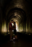 Young couple in a tunnel stock photography