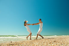 Young couple twirling on the beach Stock Photo