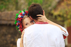 Young couple in Ukrainian national costumes hugging tenderly Royalty Free Stock Photography