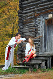 Young couple in Ukrainian style clothes flirting Stock Photos
