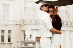 Happy young fashion couple in love with umbrella Royalty Free Stock Photos