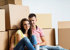 Young couple unboxing in their new home Stock Photo