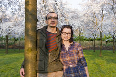 Young couple under the cherry trees Stock Photos