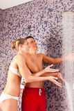Young couple under experience shower Royalty Free Stock Photo