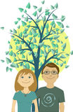 Young couple under the tree and rising sun Royalty Free Stock Images