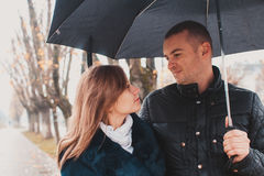 Young couple under an umbrella Royalty Free Stock Photos