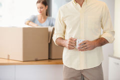 Young couple unpacking boxes in kitchen Royalty Free Stock Images