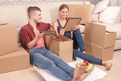 Young couple unpacking boxes Royalty Free Stock Photography