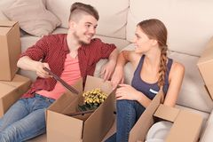 Young couple unpacking boxes Royalty Free Stock Image