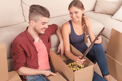 Young couple unpacking boxes Stock Photography