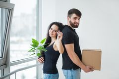 Young couple unpacking cardboard boxes at new home.Moving house. Young couple unpacking cardboard boxes at new home.Moving house Royalty Free Stock Photo
