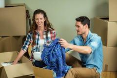 Young couple unpacking carton boxes Stock Photography