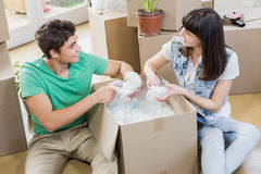 Young couple unpacking carton boxes in their new house Royalty Free Stock Photos