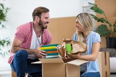 Young couple unpacking things in new home royalty free stock photos