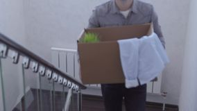 Young couple up the stairs with boxes in new house stock video