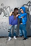 Young couple urban fashion standing portrait wall Royalty Free Stock Photos
