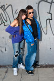 Young couple urban fashion standing portrait wall Royalty Free Stock Images