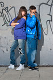 Young couple urban fashion standing portrait wall Royalty Free Stock Photography
