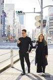 Young couple in use smartphone on a road for information in Japan Stock Photography