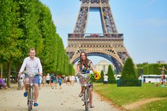 Young couple using bicycles in Paris, France Stock Photos