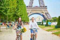 Young couple using bicycles in Paris, France Royalty Free Stock Photos