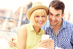 Young couple using a cellphone Royalty Free Stock Image