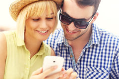 Young couple using a cellphone Royalty Free Stock Photo