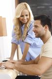Young couple using computer at home Stock Image