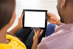 Young Couple Using Digital Tablet Stock Photos