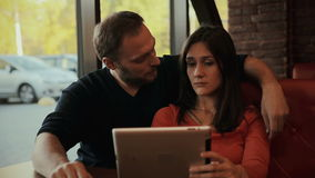 Young couple using digital tablet computer. cafe stock footage
