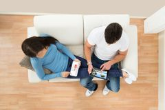 Young couple using digital tablet Stock Photography