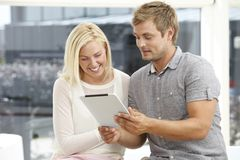 Young couple using digital tablet Royalty Free Stock Images