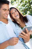 Young couple using a digital tablet Stock Image