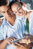 Young couple using a digital tablet Stock Photos