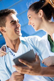 Young couple using a digital tablet Royalty Free Stock Photography