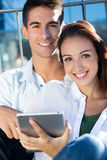 Young couple using a digital tablet Royalty Free Stock Images