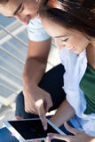 Young couple using a digital tablet Stock Photography