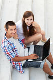 Young couple using laptop Stock Photos