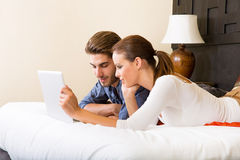 Young couple using a laptop in a asian hotel room Stock Images