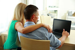 Young couple using laptop Stock Image