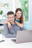 Young couple using laptop Royalty Free Stock Photography