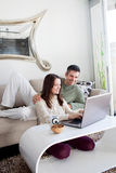 Young couple using laptop Stock Photo
